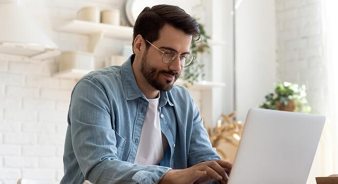 Blog man on home laptop