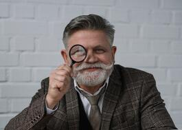 Old Man with Magnifying Glass